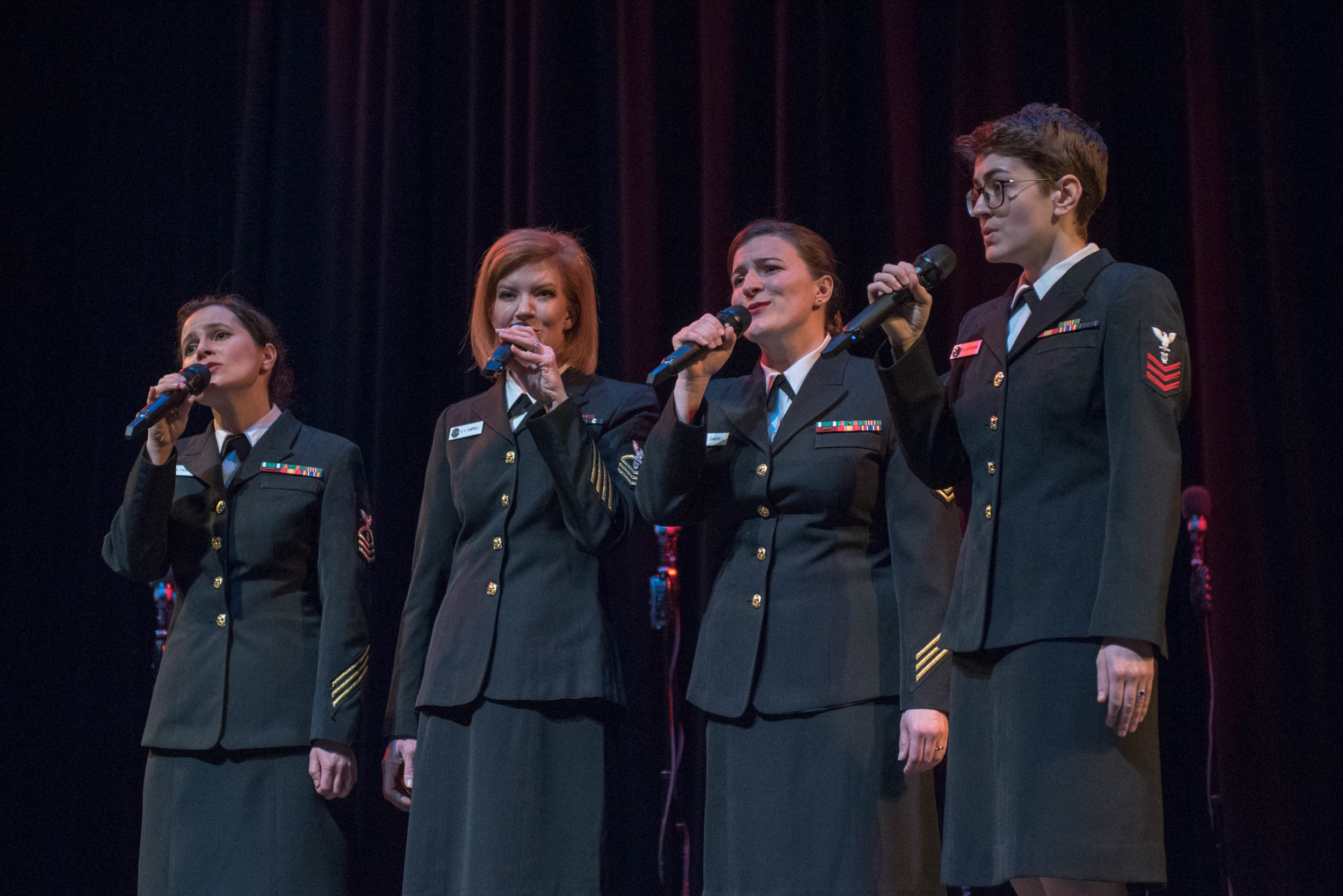 <b>The Anchor Sisters vocal trio specializes in 1940s swing and boogie woogie music made popular by groups like the Andrews Sisters and Boswell Sisters. The performers are members of the Navy's official chorus, the U.S. Navy Band Sea Chanters, based in Washington, D.C.